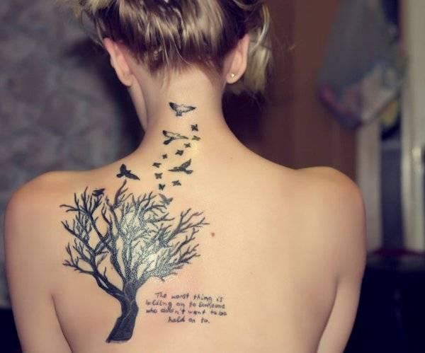 קעקוע עץ וציפורים לגב